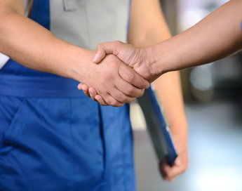 Car Technician and Client Shaking Hands